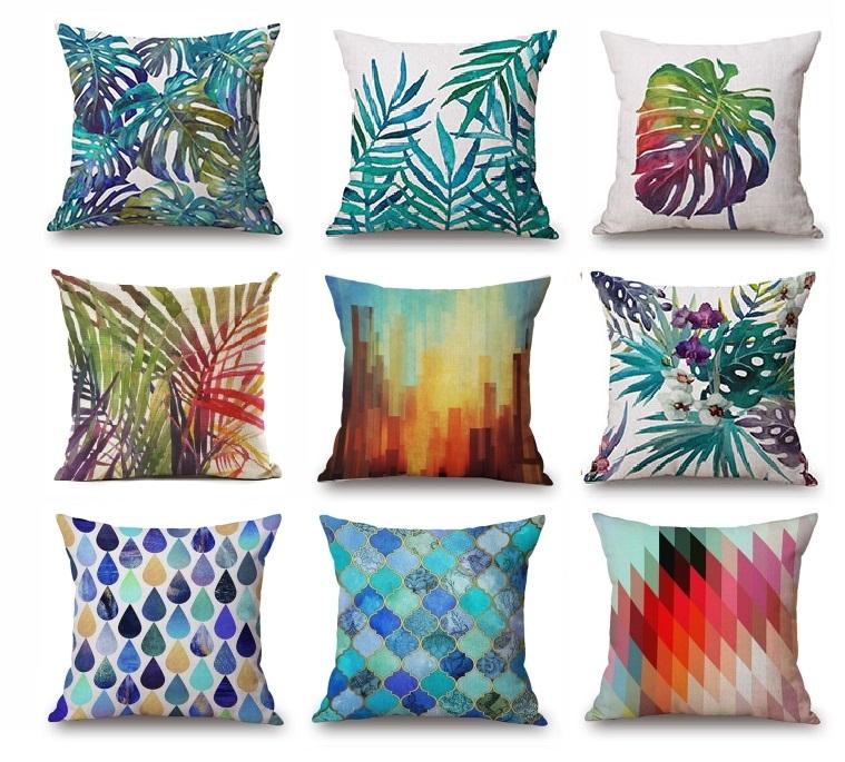 """<img src="""" Poduszki dekoracyjne zielone niebieskie kolorowe""""alt=""""poduszki egzotyczne zielone liście niebieskie kolorowe""""title=""""Poduszki dekoracyjne""""/>"""