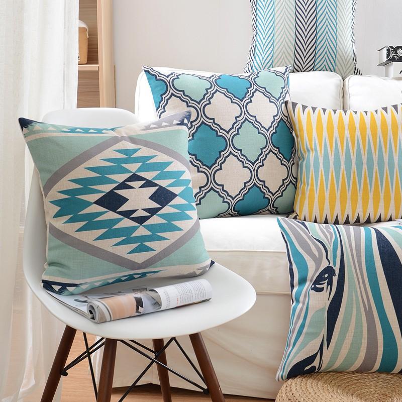 "<img src=""poduszki-dekoracyjne-allegro-ozdobne.jpg""alt=""poduszki dekoracyjne turkusowe etno zebra komplet""/>"