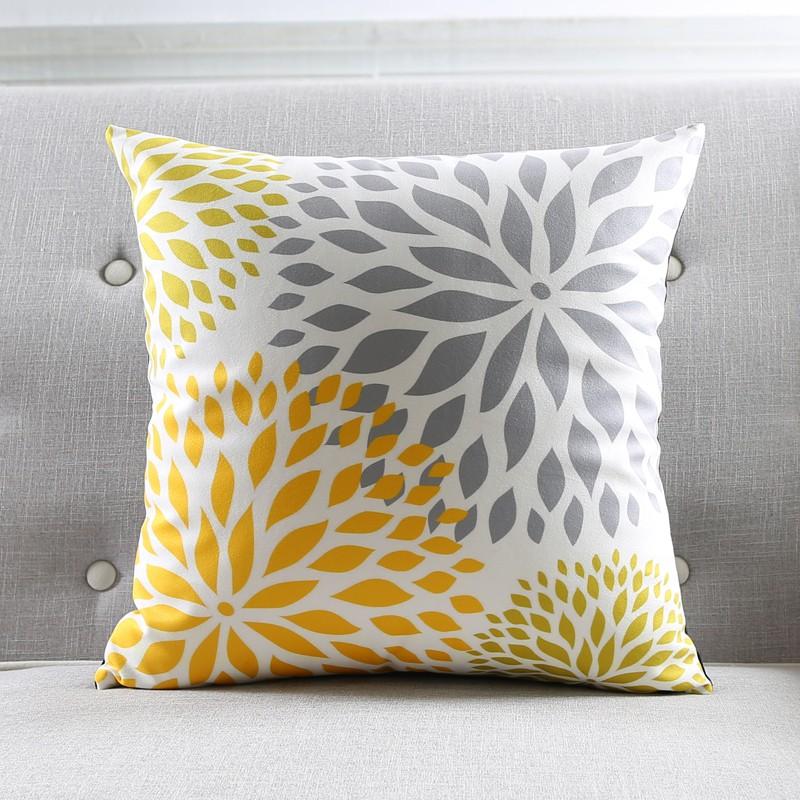 """<img src=""""poduszki dekoracyjne.jpg"""" alt=""""poduszka dekoracyjna żółty kwiat szary""""/>"""